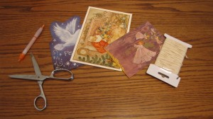 old greeting cards, scissors, a pen and twine